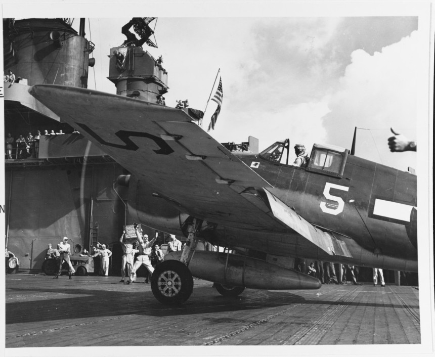A VF-1 Top Hatter F6F-3 fighter is launched from USS YORKTOWN, to intercept enemy forces during Mariana's turkey shoot 19 June 1944. Note target information board under the propeller. 80-G-248440