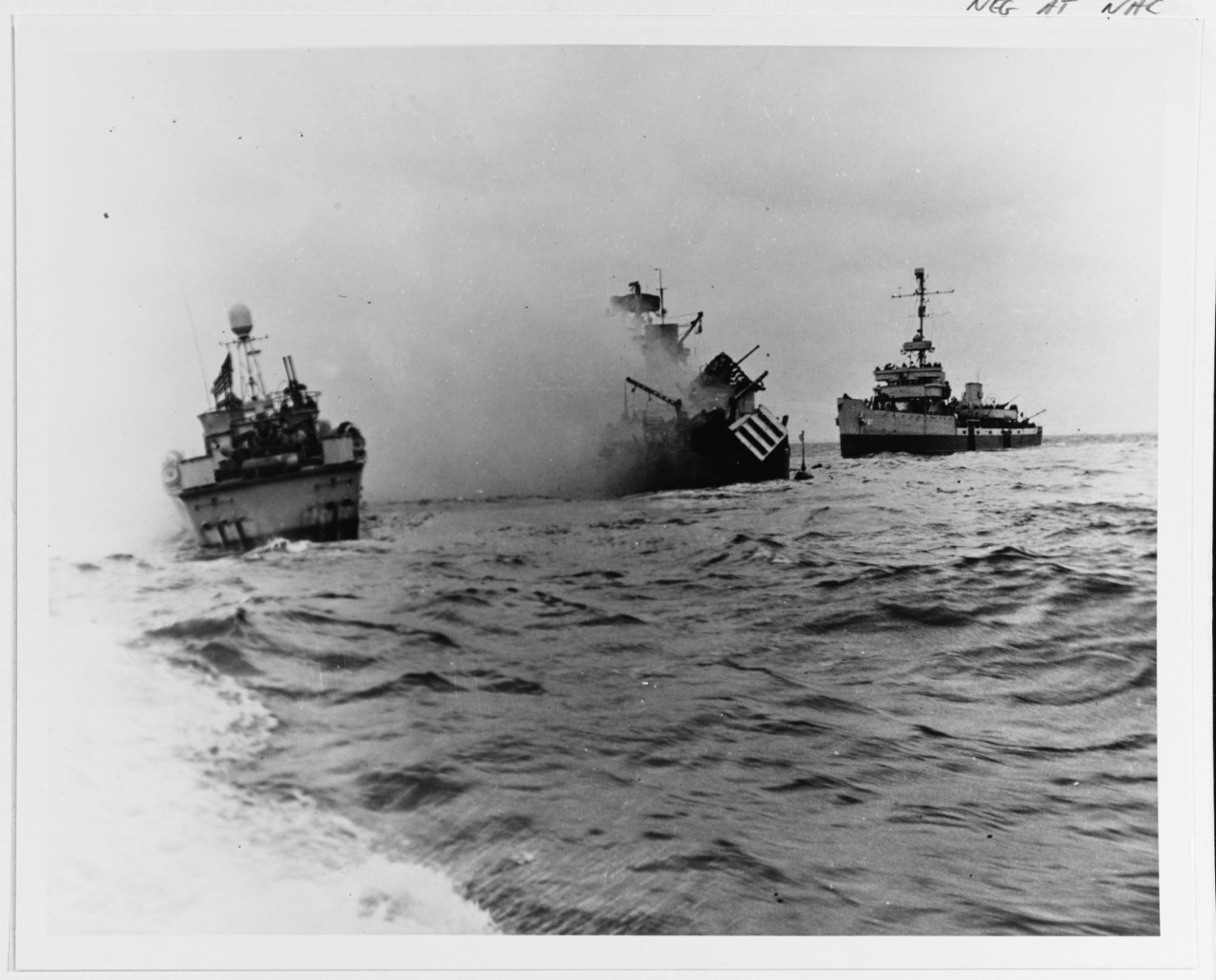 Auk-class minesweeper USS Tide (AM-125) sinking off Utah Beach after striking a mine during the Normandy invasion, 7 June 1944. USS PT-509 and USS Pheasant (AM-61) are standing by. Photographed from USS Threat (AM-124). 80-G-651677