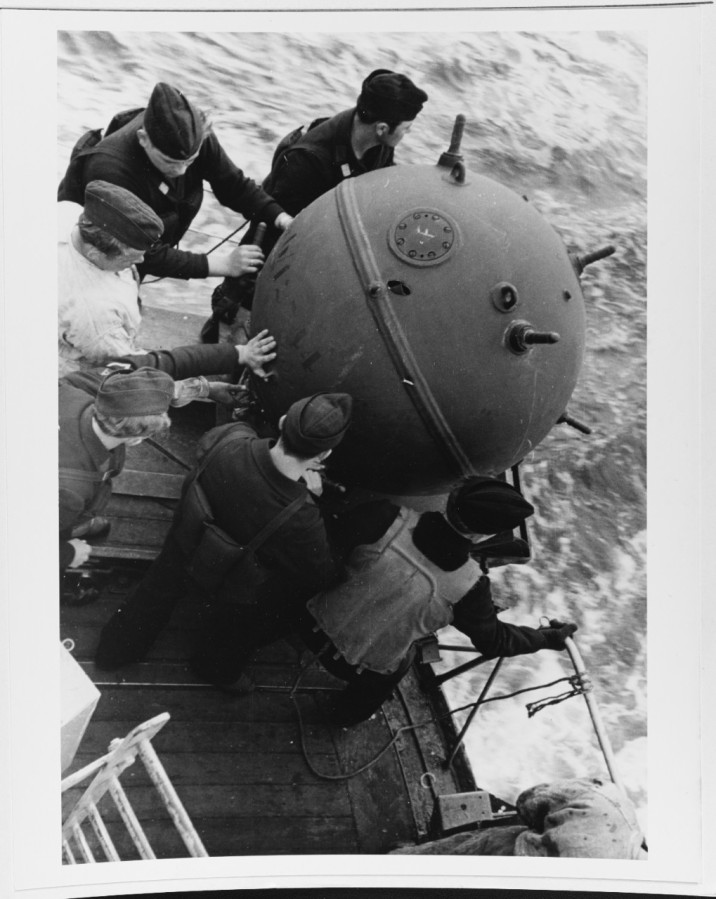 Dropping mines from a German mine layer during World War II. The Seemine looks to be an EMC-type contact mine which used a charge of 551-pounds. The Germans were fans of contact (with both Hertz and three horns) and magnetic influence mines in moored and drifting flavors and used them liberally during the war from Greece to Norway, often with anti-sweep obstructors. NH 71333