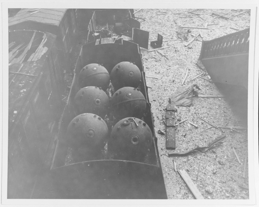 German sea mines in a railroad car, abandoned in the railway station at Cherbourg, France, 3 July 1944. 80-G-254312