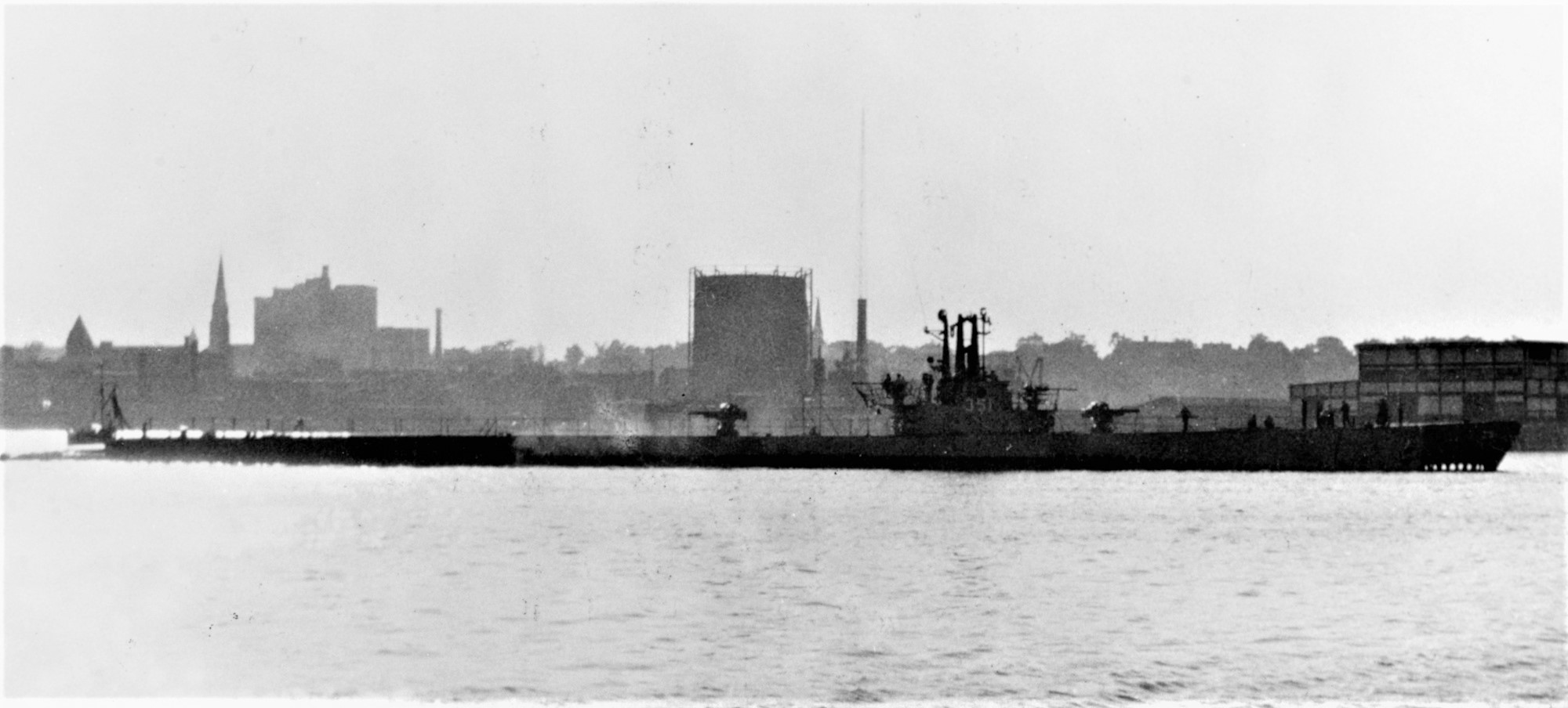 Greenfish in her as-built WWII-configuration, shown off Groton, Connecticut, in October 1947. Note her forward and aft 5-inch guns as well as her 40mm and 20mm cannon on the sail. Courtesy of D.M. McPherson, 1974. Catalog #: NH 79772