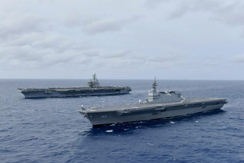 SOUTH CHINA SEA (June 11, 2019) The Navy's forward-deployed aircraft carrier USS Ronald Reagan (CVN 76), left, operates with the Japan Maritime Self-Defense Force (JMSDF) helicopter destroyer JS Izumo (DDH 183), June 11, 2019. The ships, along with the JMSDF destroyers JS Murasame (DD 101) and JS Akebono (DD 108) conducted communication checks, tactical maneuvering drills and liaison officer exchanges, June 10-12, designed to address common maritime security priorities and enhance interoperability at sea. (U.S. Navy photo courtesy of JMSDF/Released)