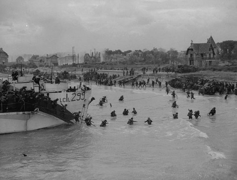 "looking east along the ""Nan White"" beach, showing personnel of the 9th Canadian Infantry Brigade landing on D-Day"