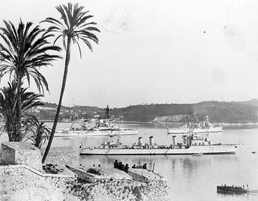 NH 110742 French Warships in port, circa 1939 Mediterranean palm trees and old fort 2400-tonne type destroyer battleship Courbet, while a Duguay Trouin class light cruiser is to the right