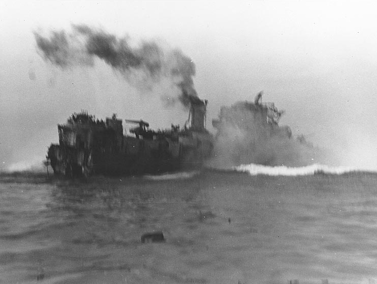 The U.S. Navy destroyer escort USS Rich (DE-695) strikes a mine, amidships, while operating off Normandy, France, on 8 June 1944. She had previously hit another mine, which blew off her stern. NH 44312