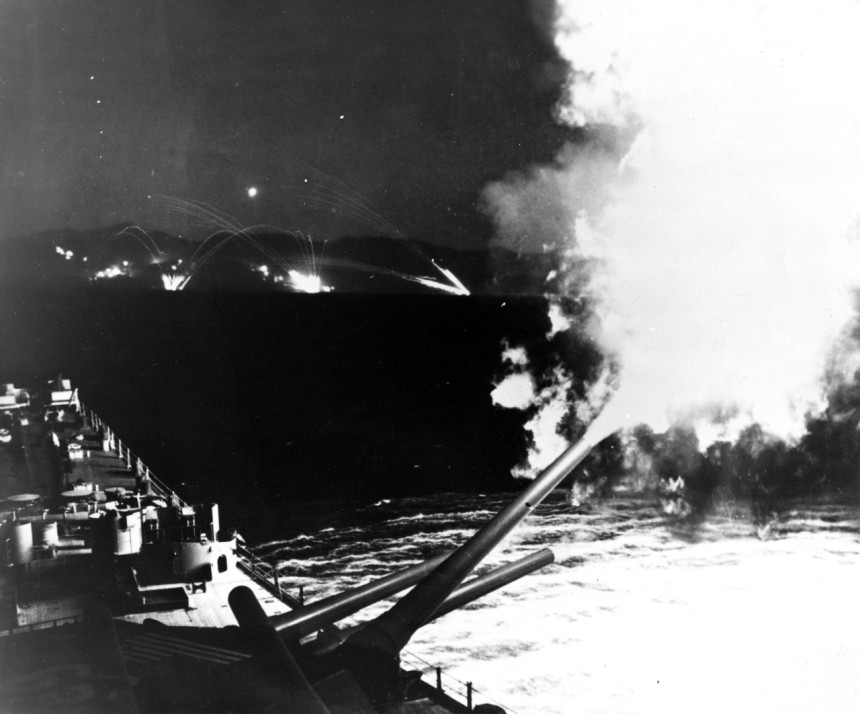 USS Missouri (BB-63) Forward turret fires a 16-inch shell at enemy forces attacking Hungnam, North Korea, during a night bombardment in December 1950 LSMR NH 96811