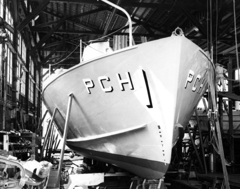 The Navy's first hydrofoil submarine chaser, USS High Point (PCH-1), nears completion at the J.M. Martinac Shipbuilding Corporation, Tacoma, WA. In this photograph the after foil and starboard nacelle are visible. Accession #: L45 Catalog #: L45-125.04.02