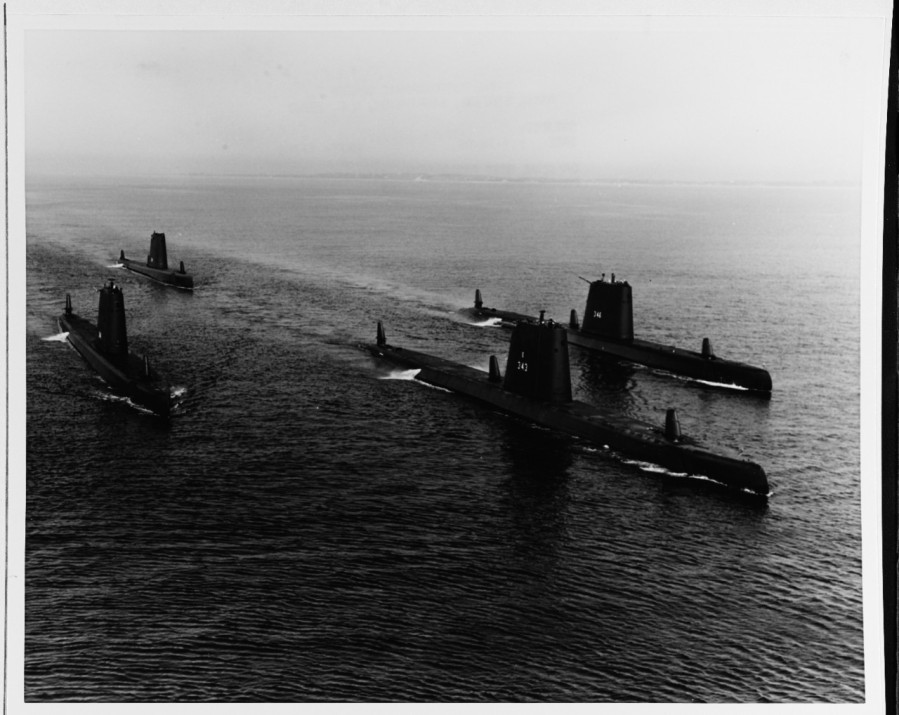 In formation on 18 April 1966. The boats seen are: USS BLENNY (SS-324), CLAMAGORE (SS-343), COBBLER (SS-344), and CORPORAL (SS-346)