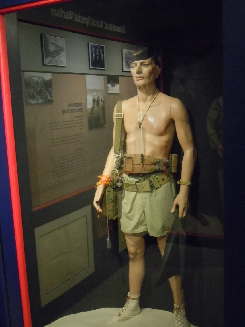 A model of the typical late-war UDT swimmer shown at the SEAL/UDT Musesum in Ft. Pierce. Note the dive mask, boots for use on coral, swim trunks, emergency life belt, demo bag, fins and knife. Around his chest is a board for drawing his section of beach. (Photo: Chris Eger)