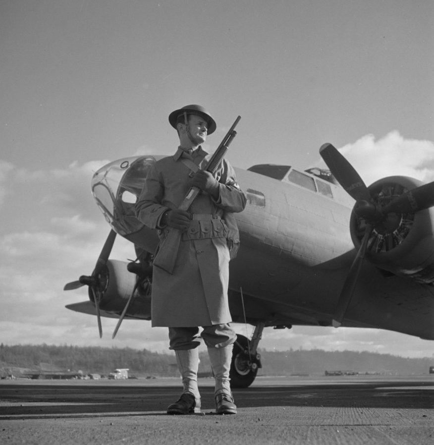 Dec. 1942 Production. B-17 heavy bomber Army sentry Boeing's Seattle plant Winchester 12 shotgun riot gun