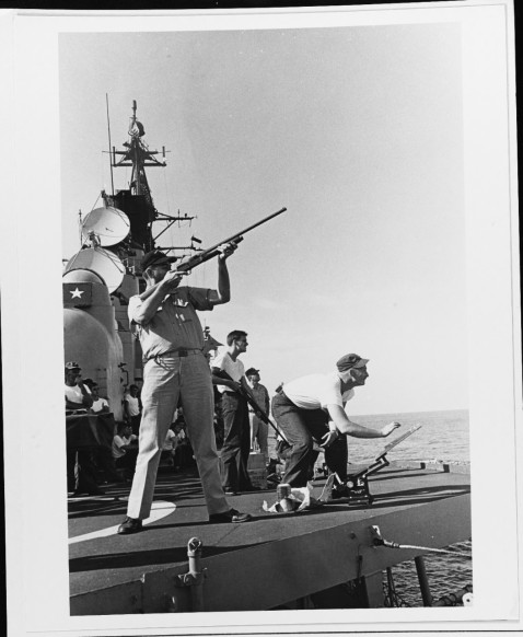 During a lull in Vietnam combat ops in the Gulf of Tonkin, the deck of USS HOEL (DDG-13) becomes a skeet range, December 1966. USN 1119308