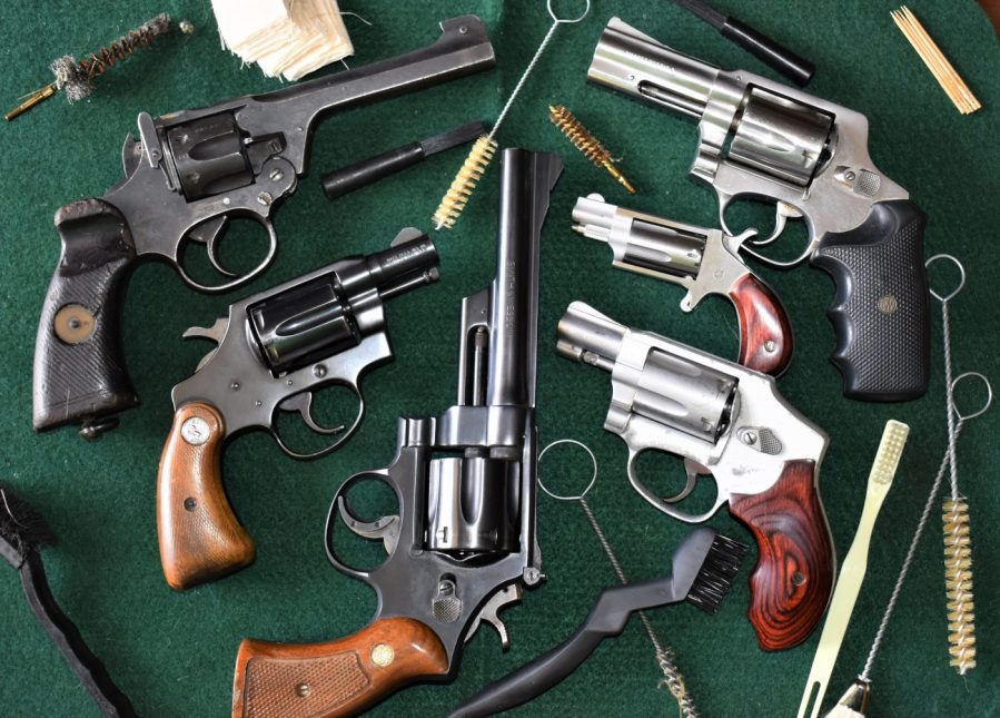 The spread includes a WWII British Enfield No.2 Mk I* in .38/200, a Colt Detective Special, Smith & Wesson Model 28 Highway Patrol in .357 Magnum, S&W 642 Airweight, a North American Arms .22WMR Mini Revolver and a 1970s Rossi M720 .44 Special.