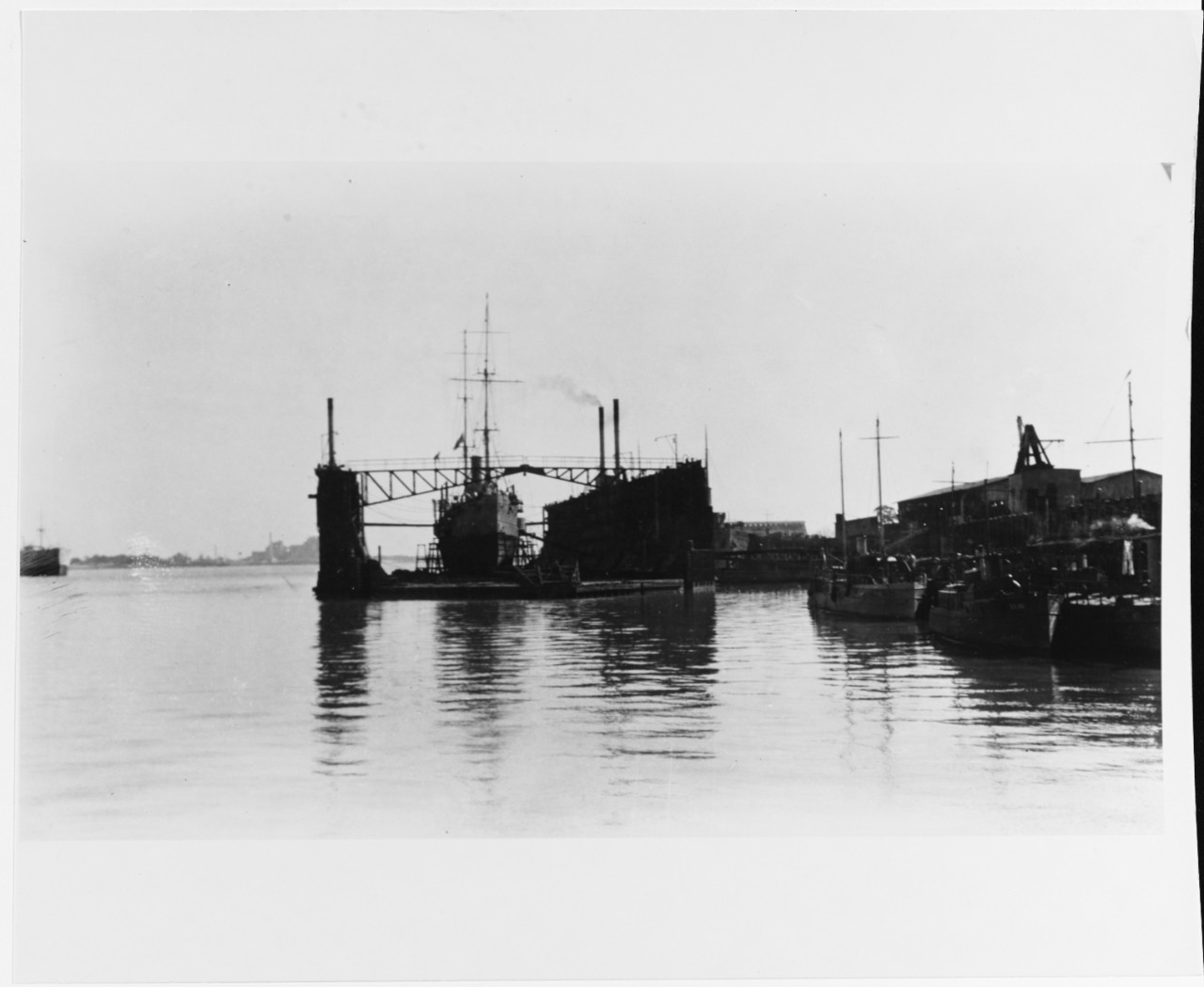 In floating drydock at the New Orleans Naval Station, January 1918. Note SP boats. Courtesy of John G. Krieger, 1967 NH 43471